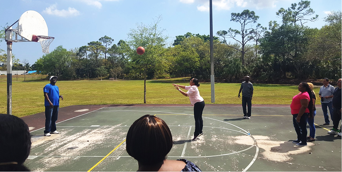 employees playing basketball